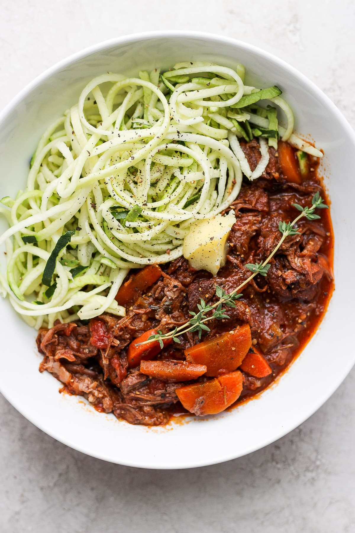 Bowl of beef ragu with zucchini noodles.