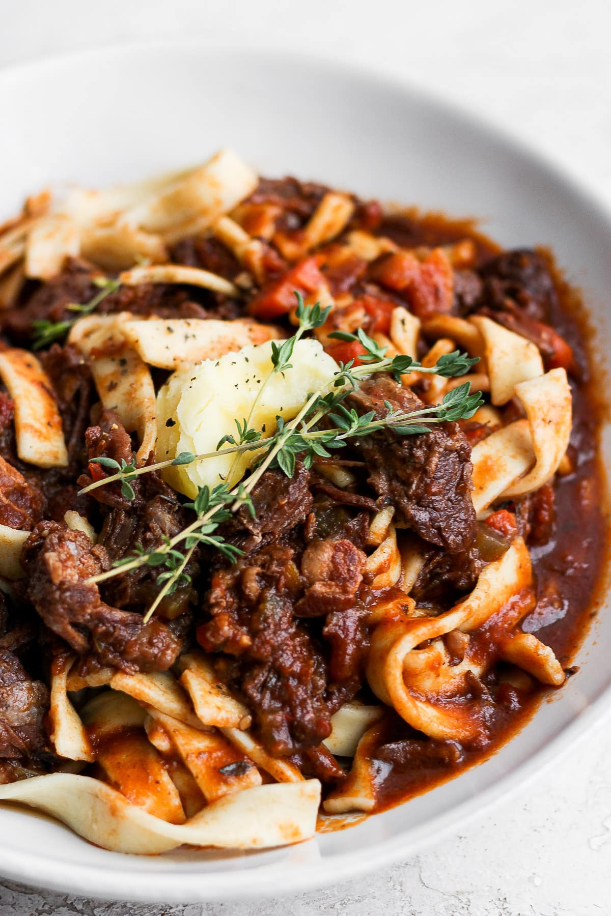 Bowl of beef ragu with pasta.