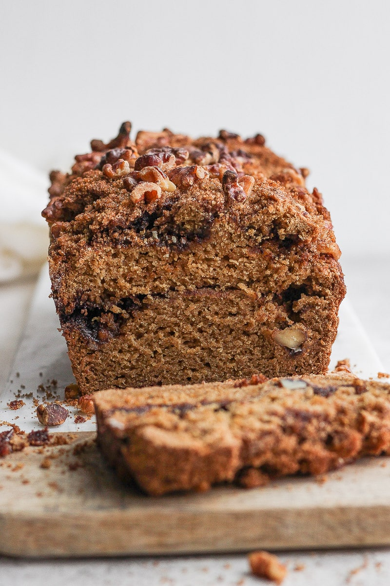Loaf of gluten-free coffee cake with a slice cut off the end.