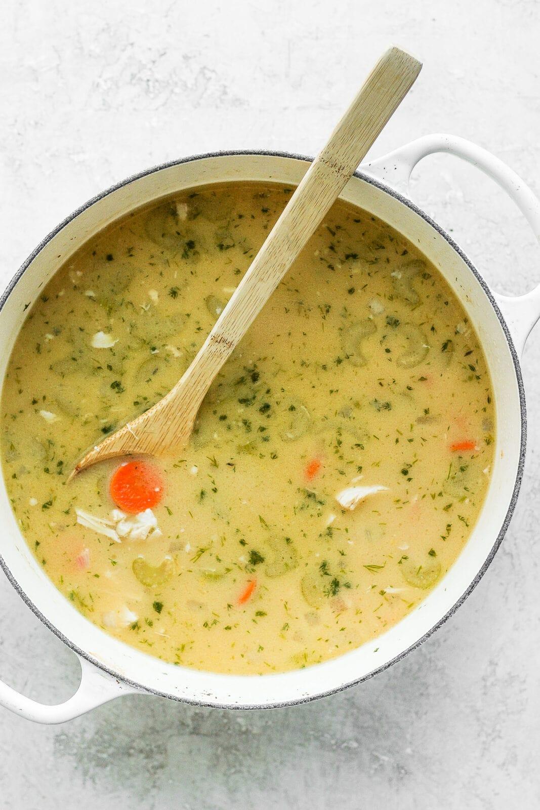 Dutch oven of greek lemon chicken soup.