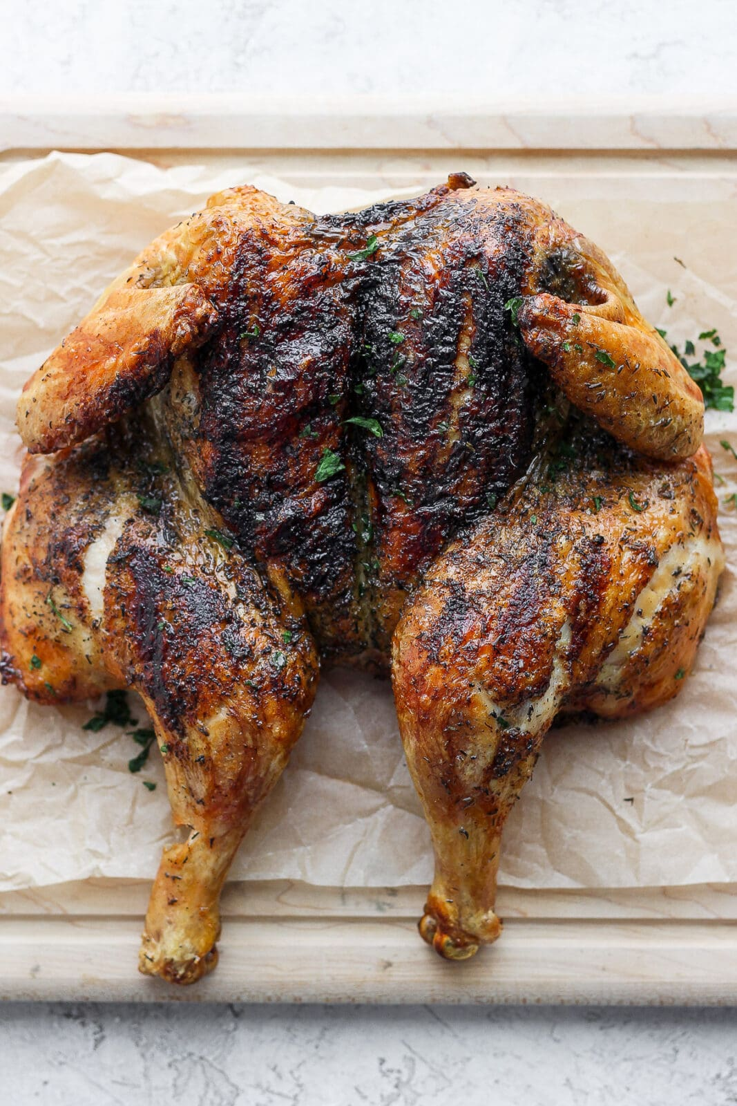 Picture of a grilled spatchcock chicken.