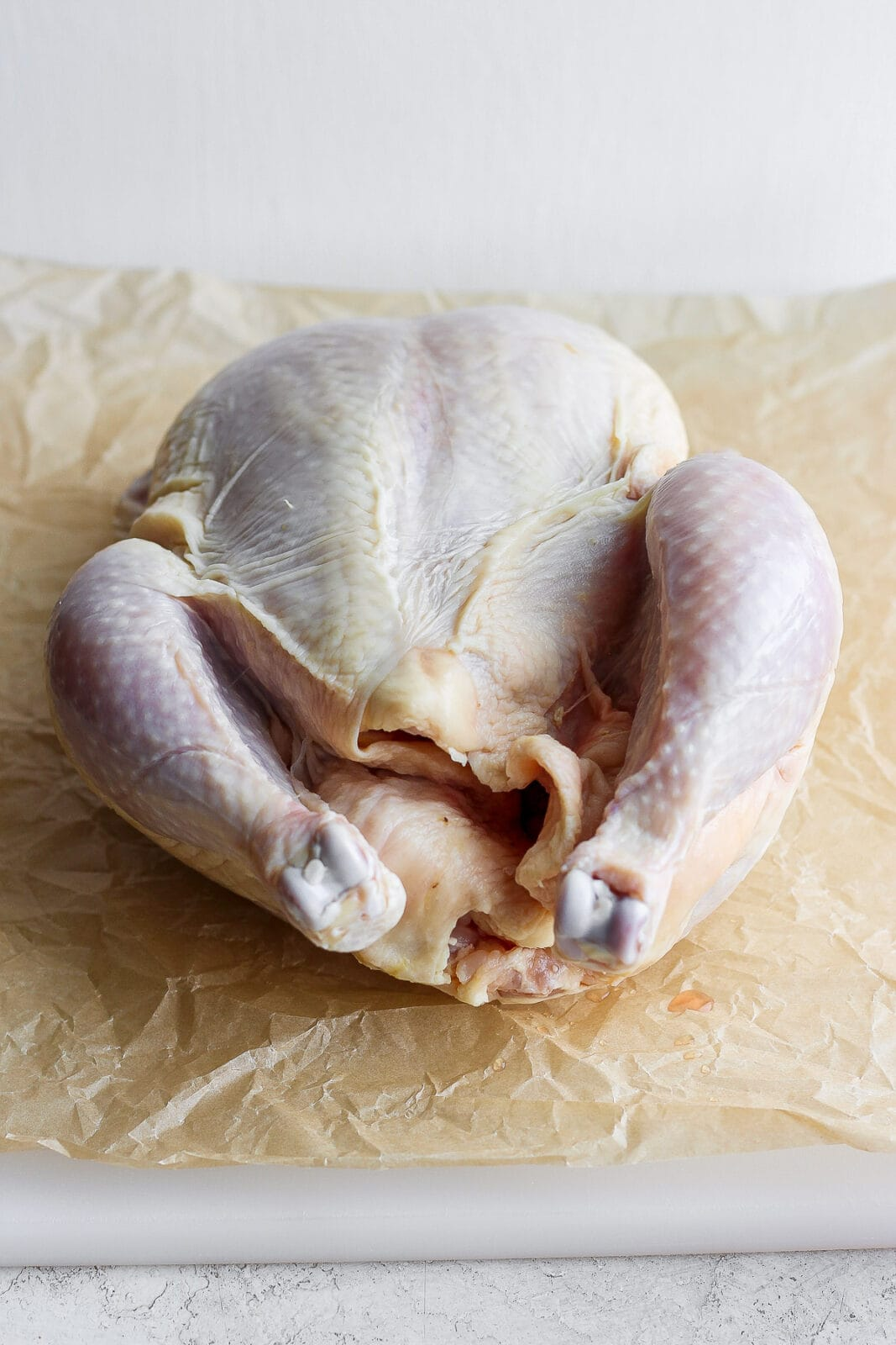 A whole, raw chicken.