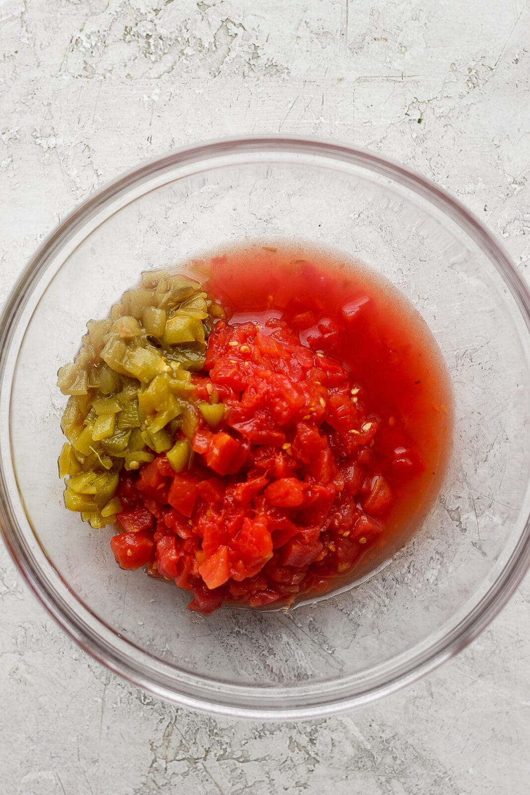 Bowl of tomatoes and green chiles.