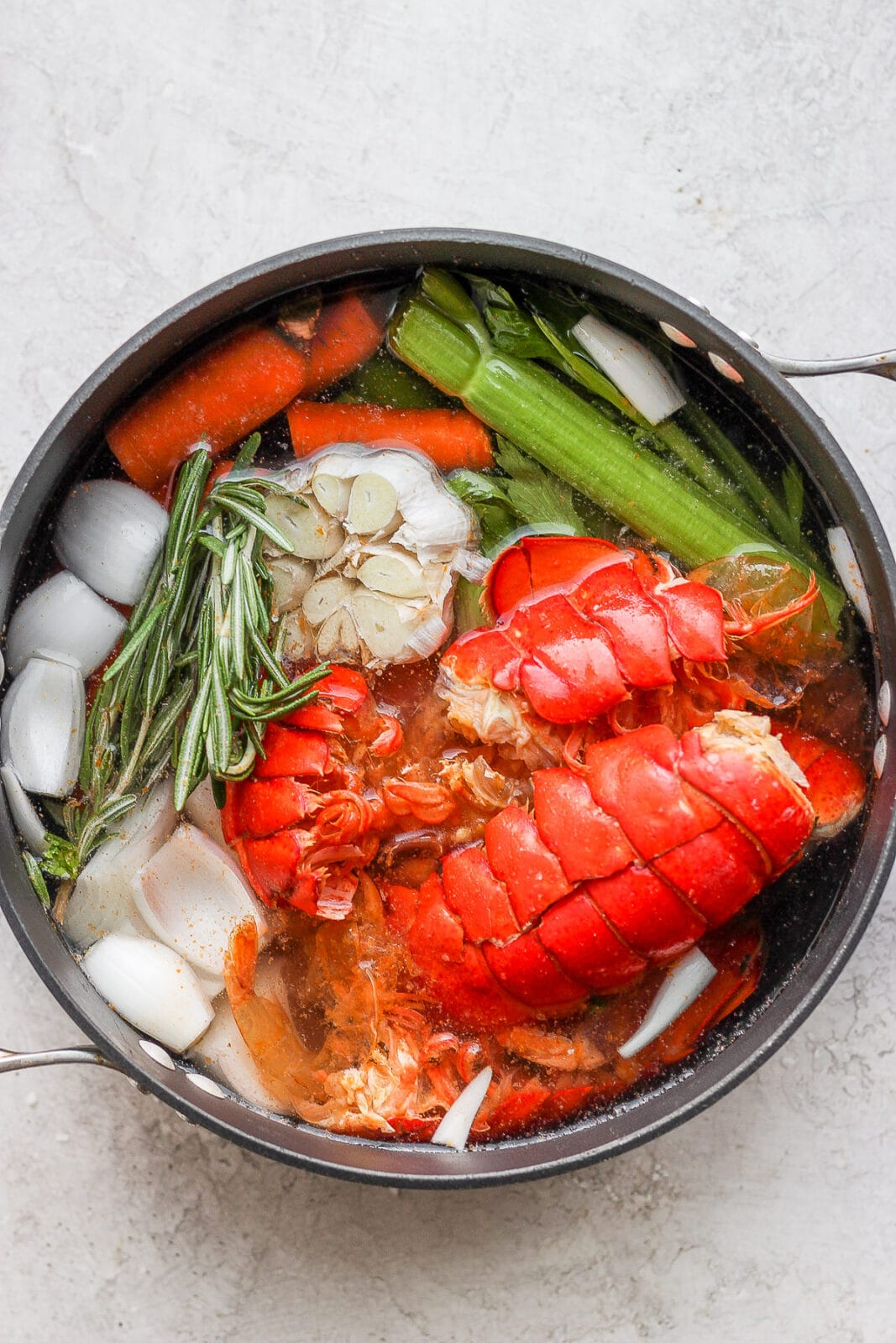Dutch oven with seafood stock ingredients plus water.