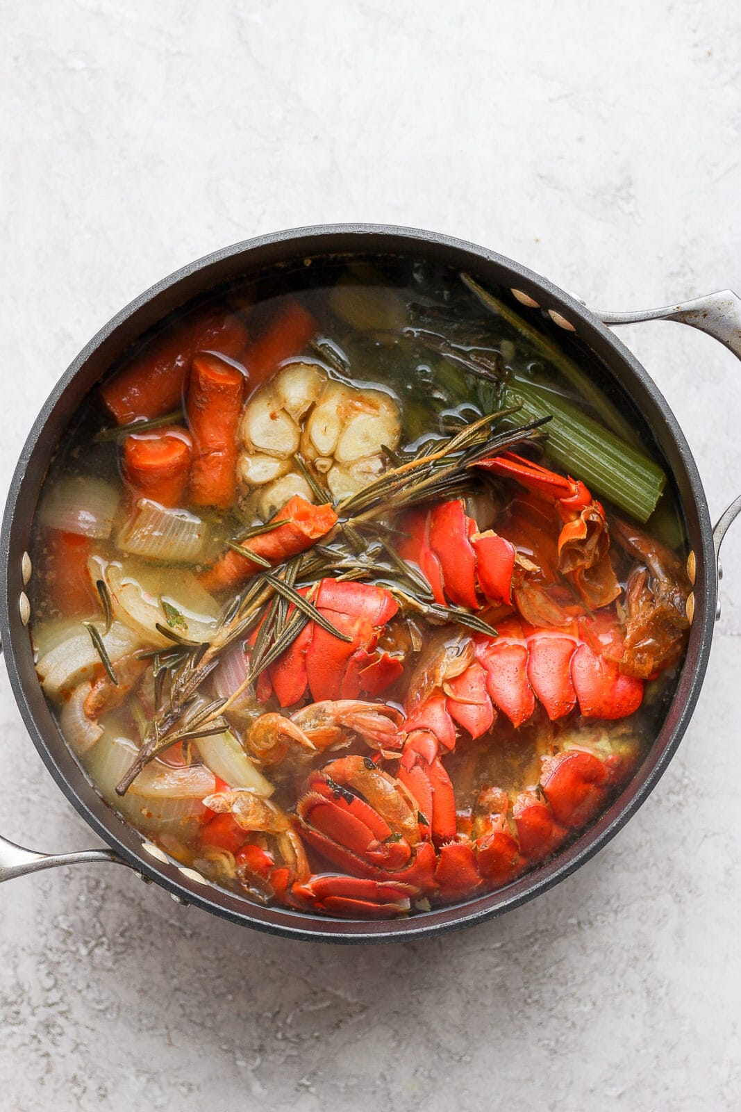 Dutch oven with seafood stock after simmering.