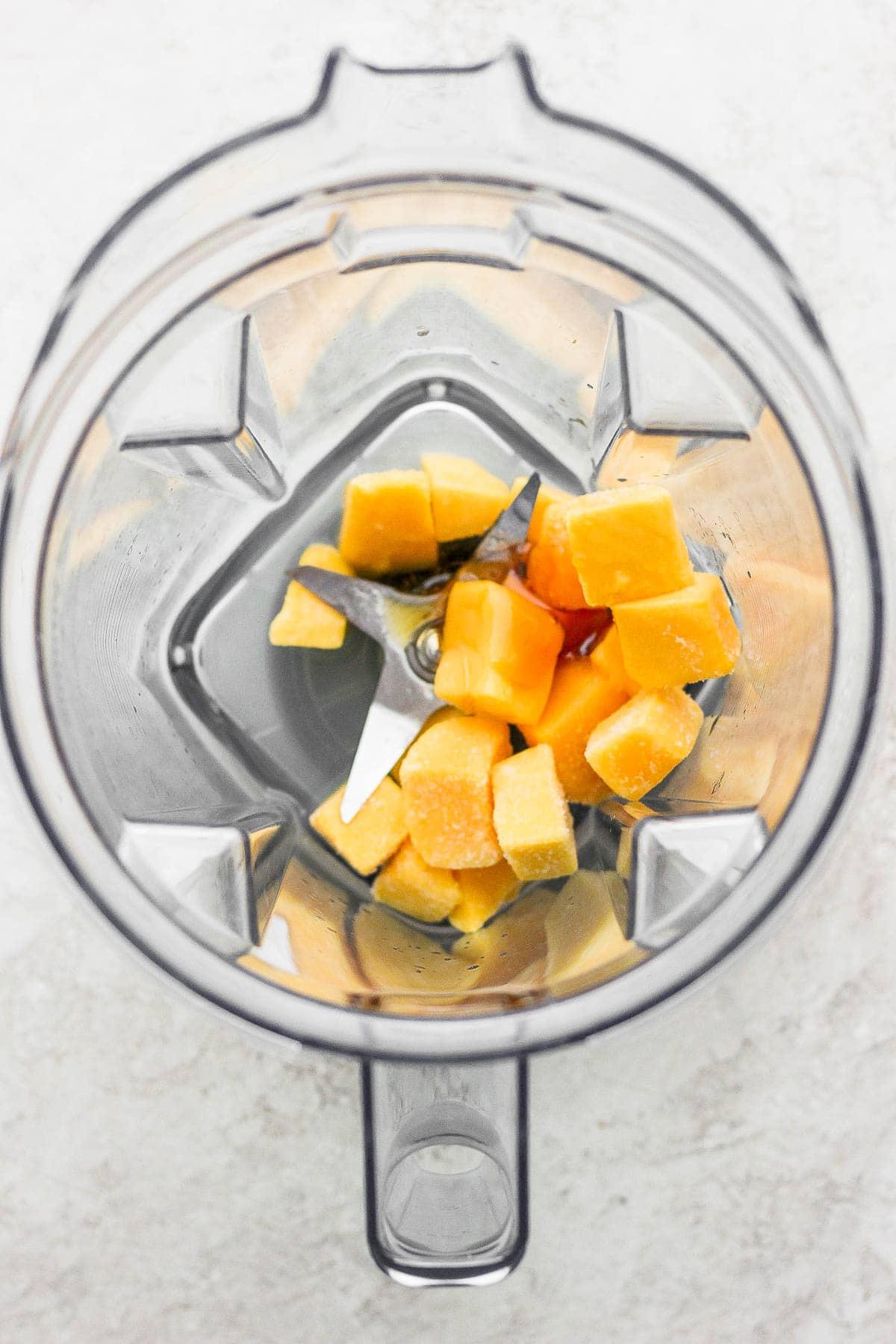 Ingredients for mango margaritas in a blender.