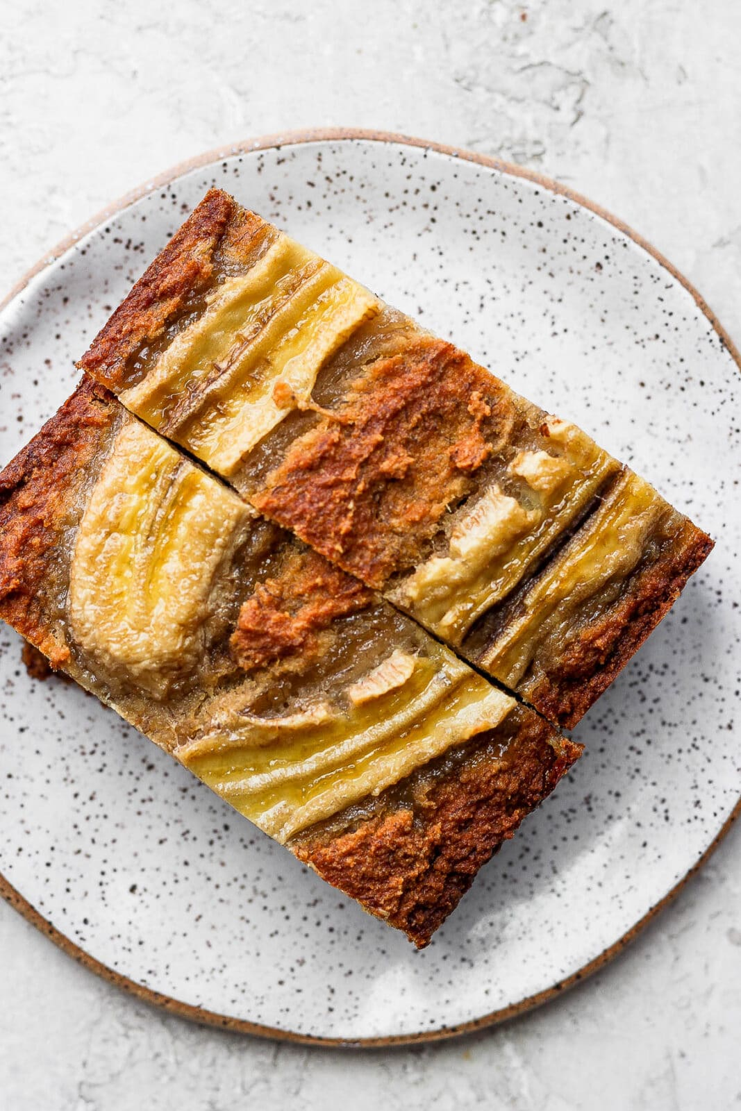 A plate with 2 slices of paleo banana bread.