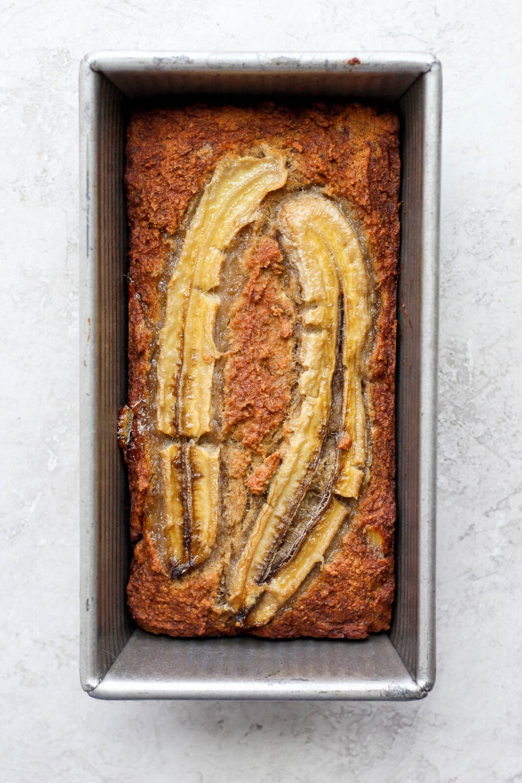 Baked paleo banana bread in a loaf pan.