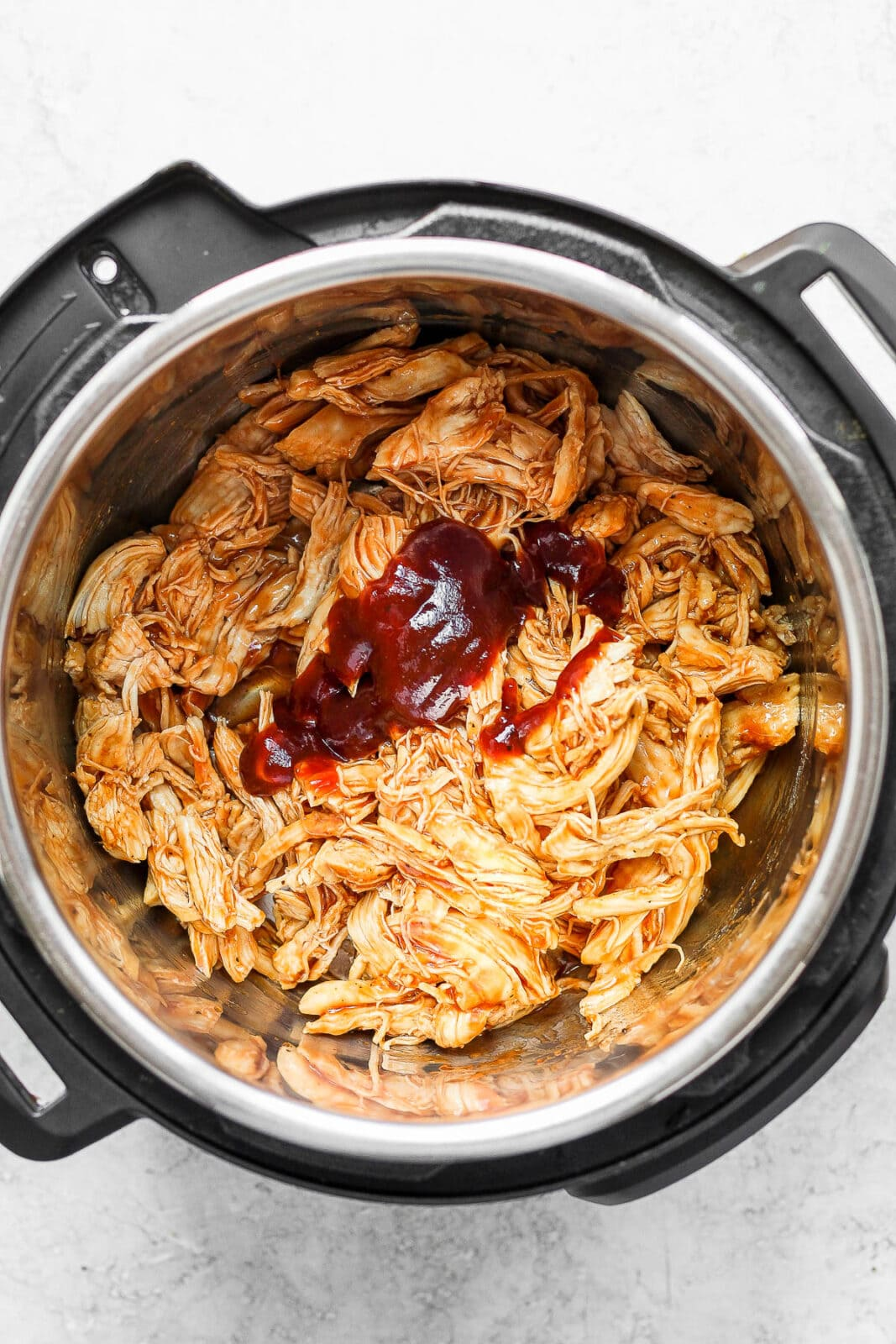 Shredded BBQ chicken in an Instant Pot.
