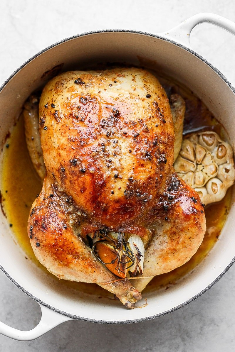 Whole roasted chicken in a dutch oven.