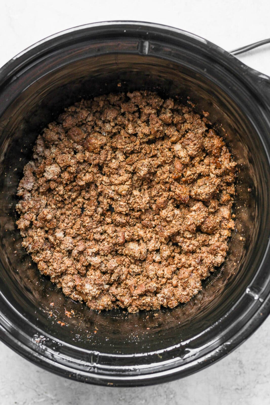 Crockpot with cooked taco meat.