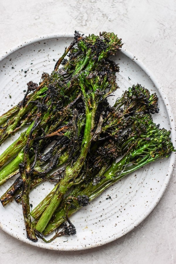 Grilled broccolini on a plate.