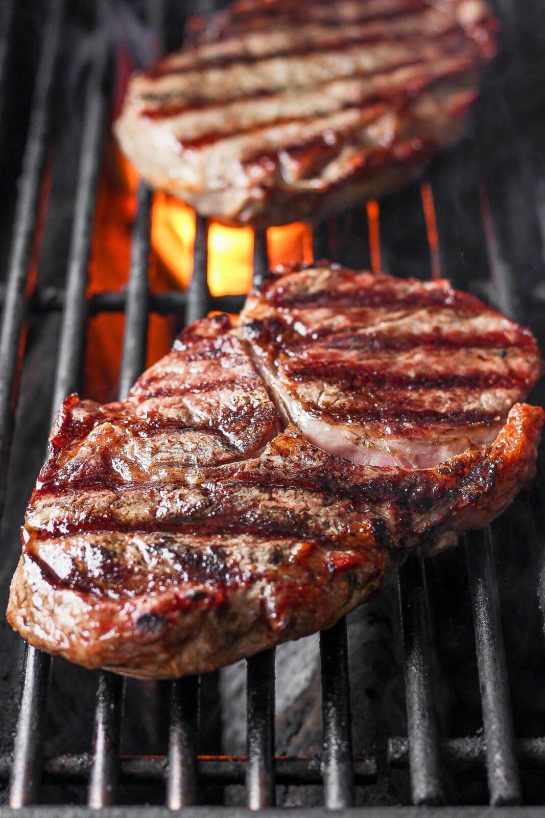 A ribeye steak on a grill.