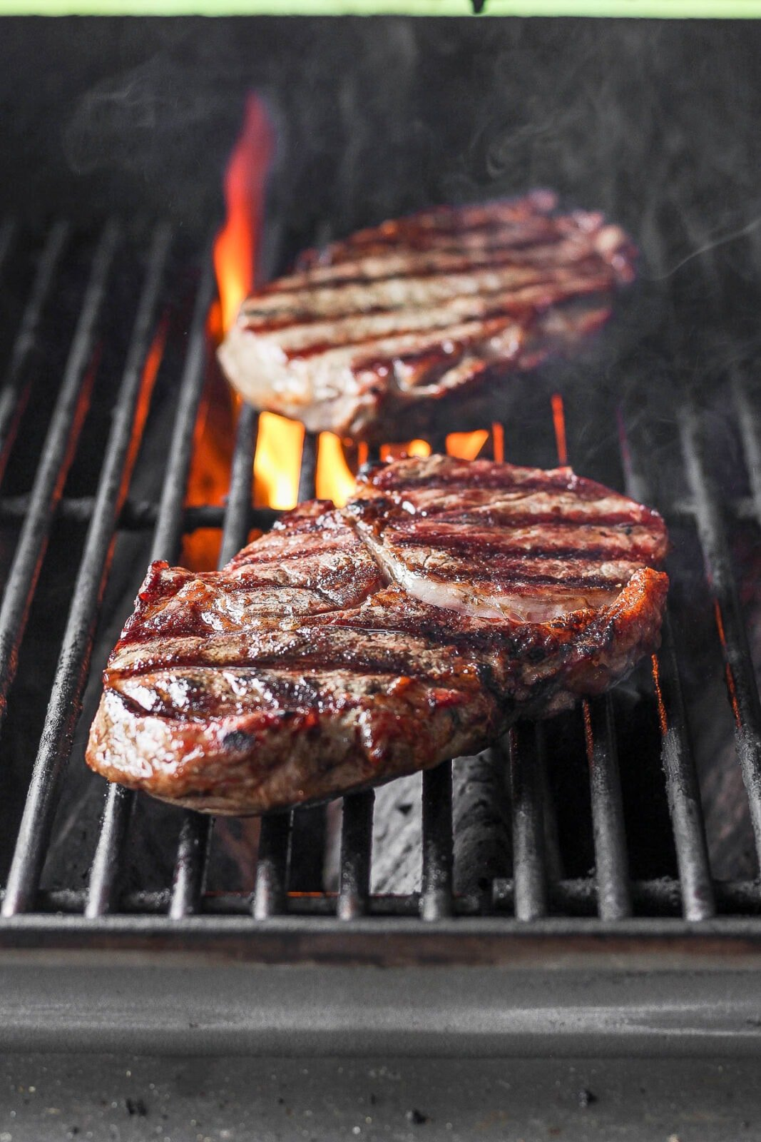 Two steaks on the grill.