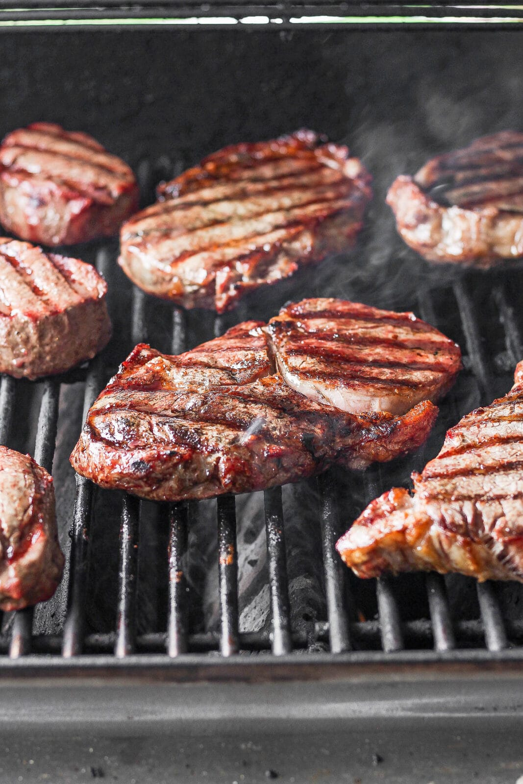 Grilled steaks on a grill.
