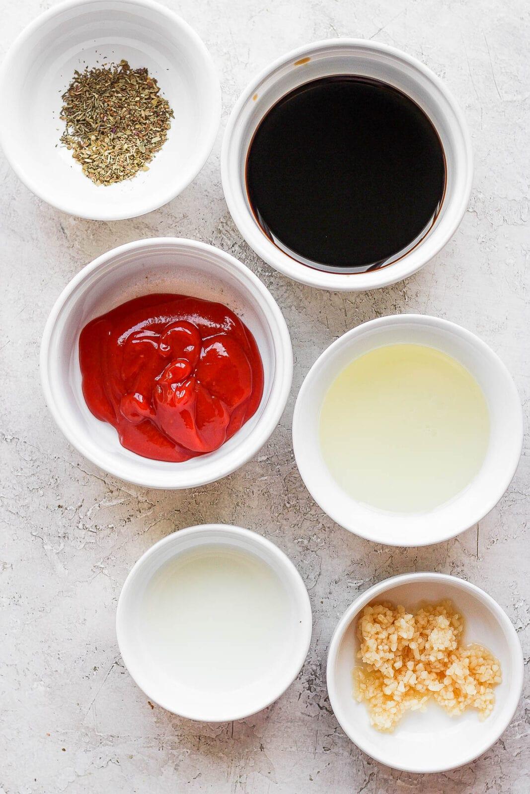 Ingredients for a pork tenderloin marinade in separate bowls.