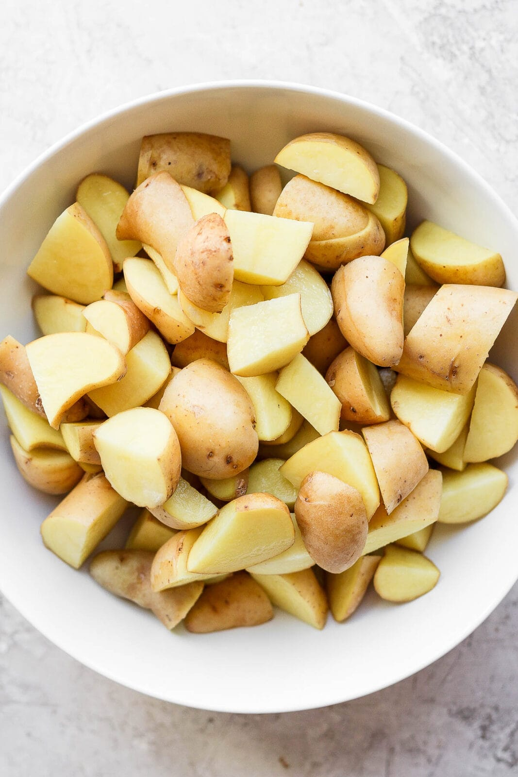 Bowl of cut-up potatoes in a bowl.