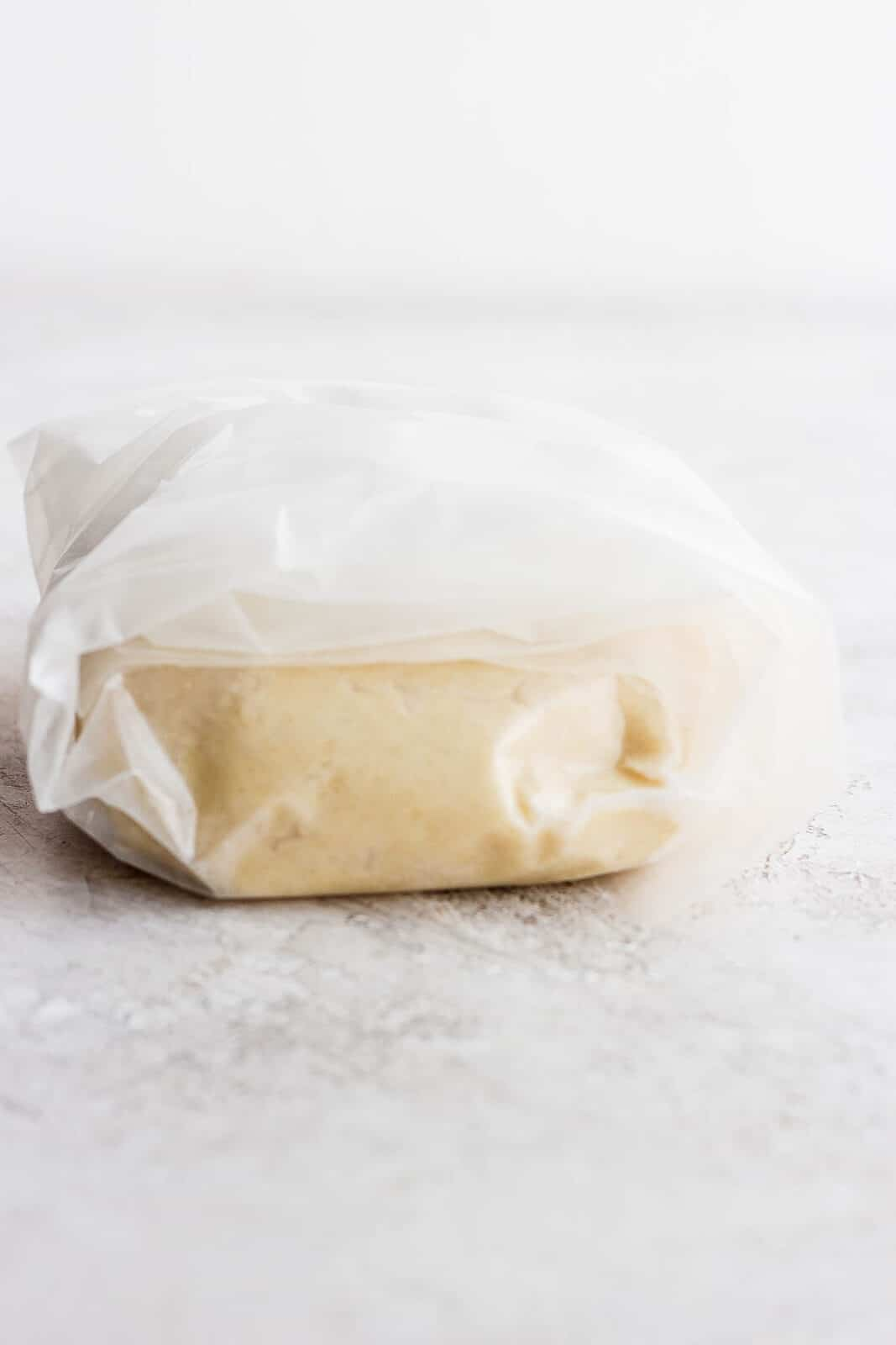 Dough wrapped in wax paper.