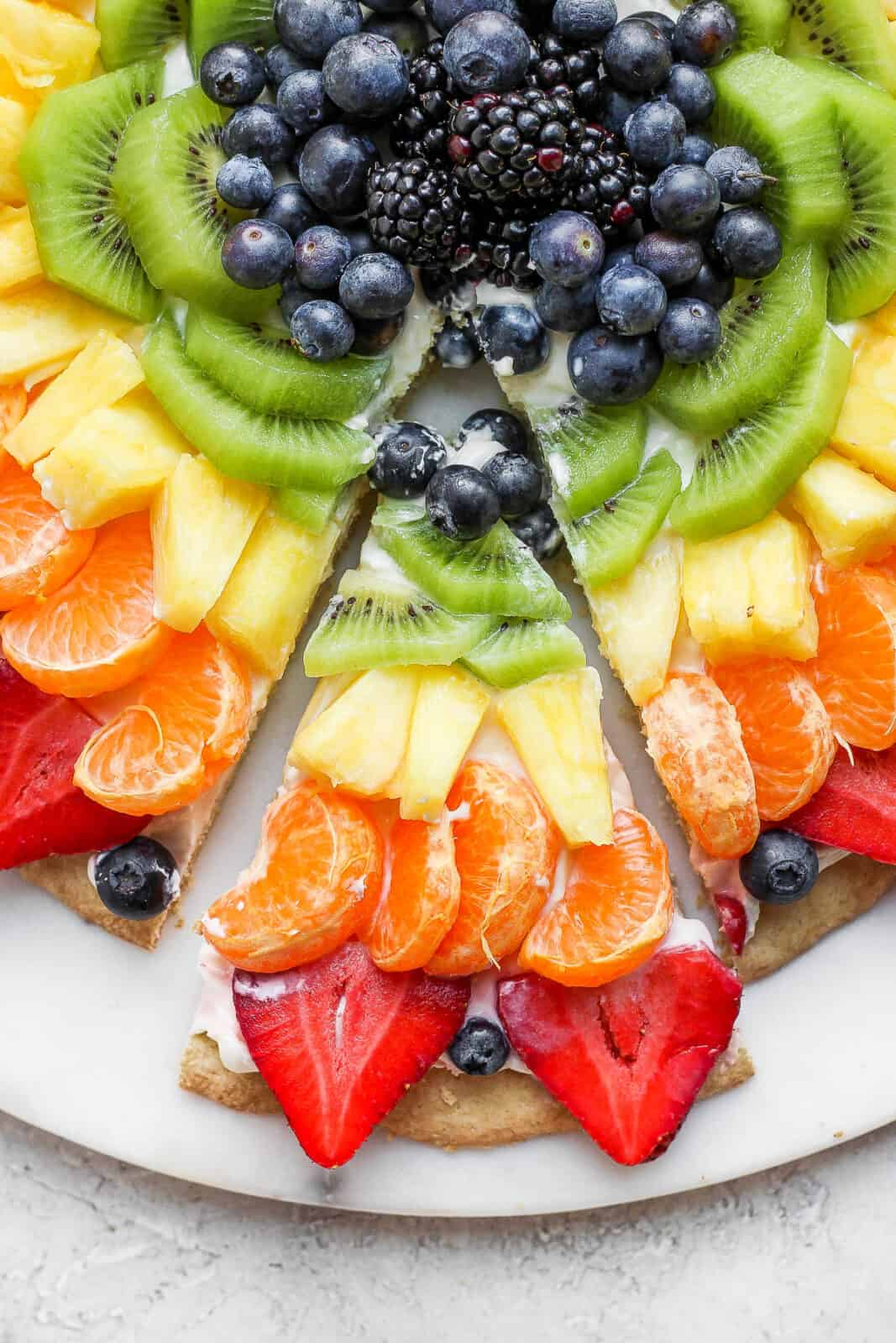 A close-up of a slice of fruit pizza.