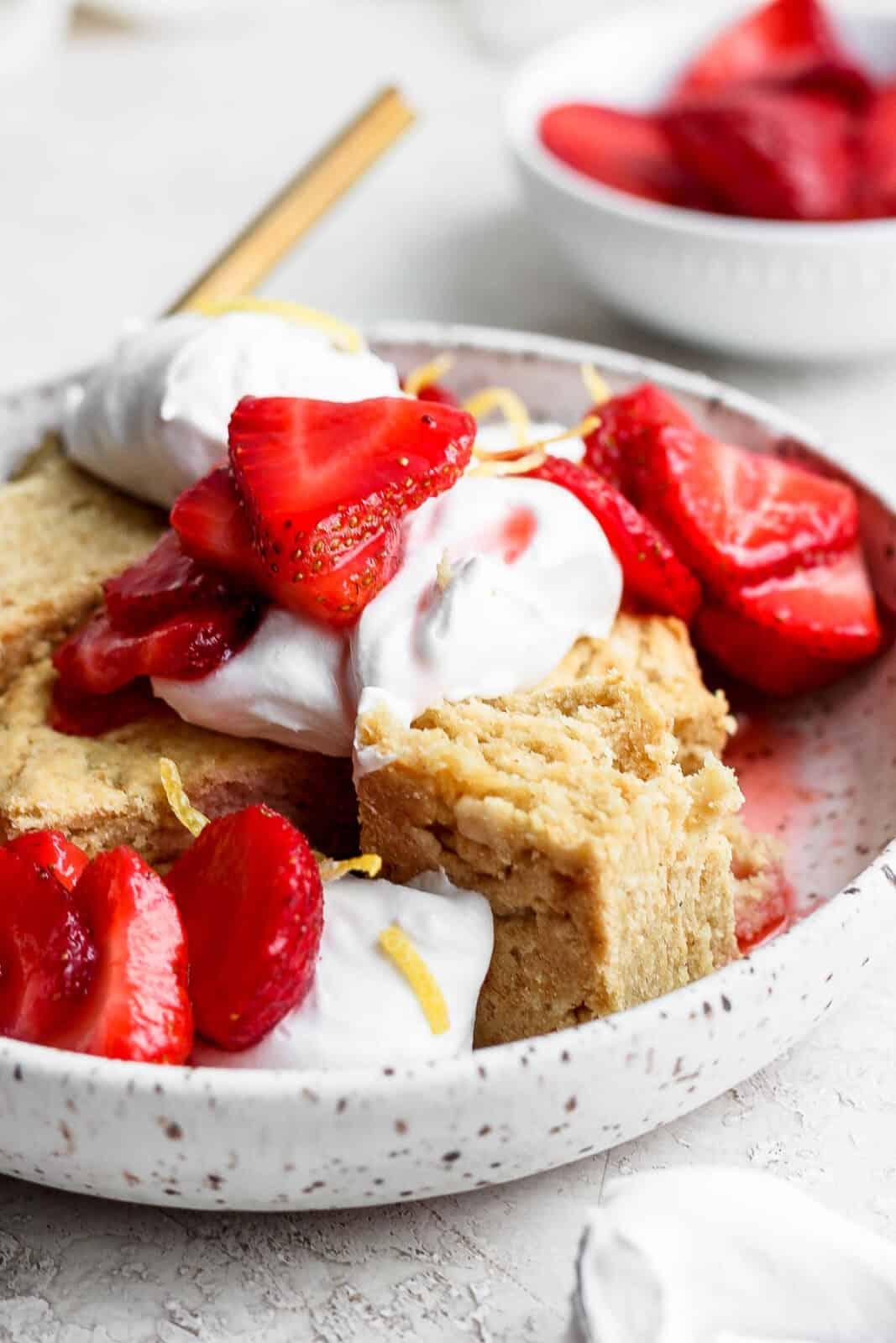 Bowl of gluten free strawberry shortcake.
