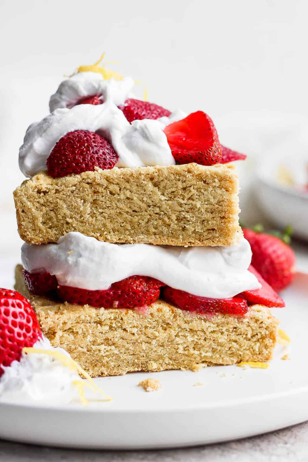 Strawberry shortcake with strawberries and whipped cream on top.
