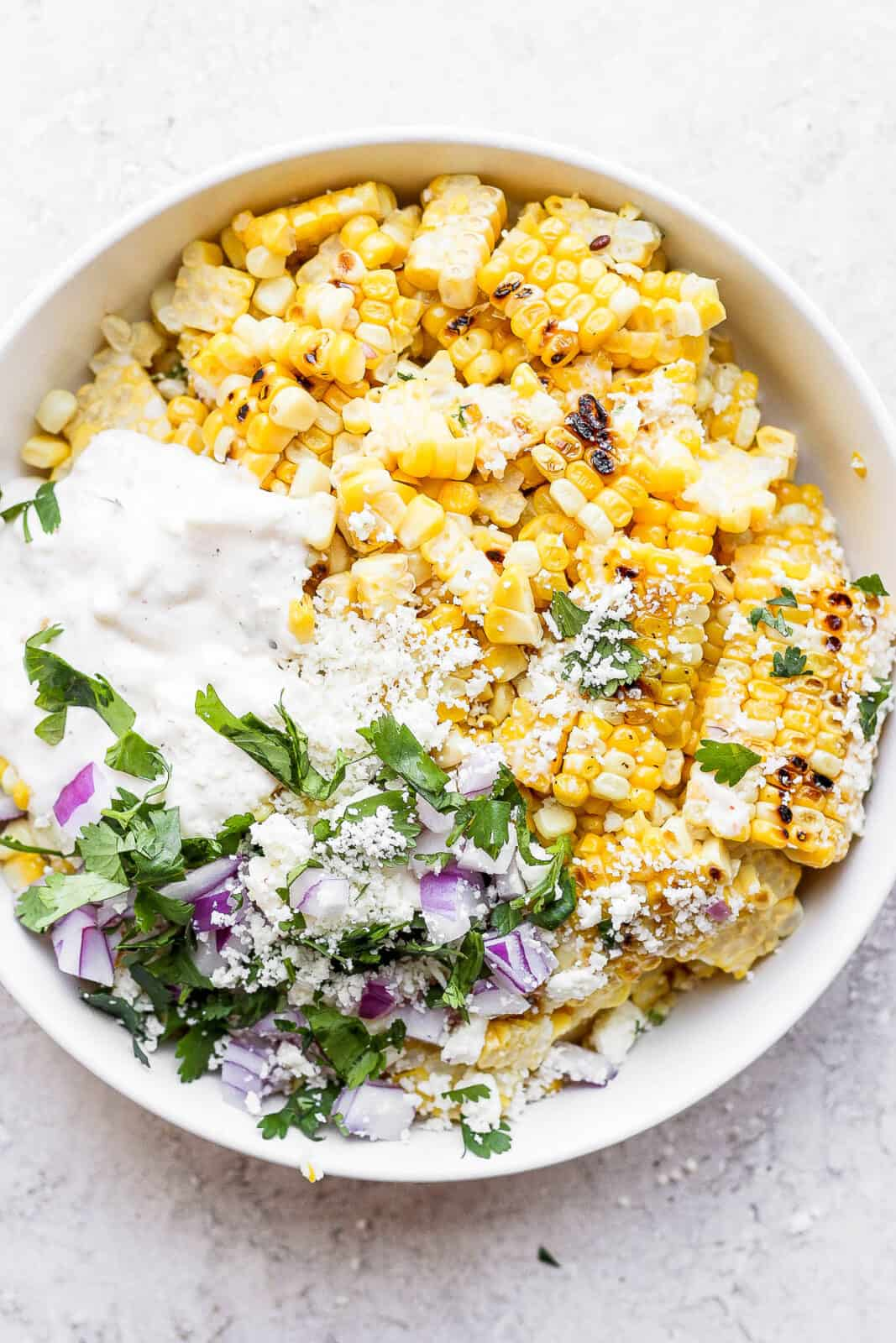 Mexican street corn salad in a bowl.