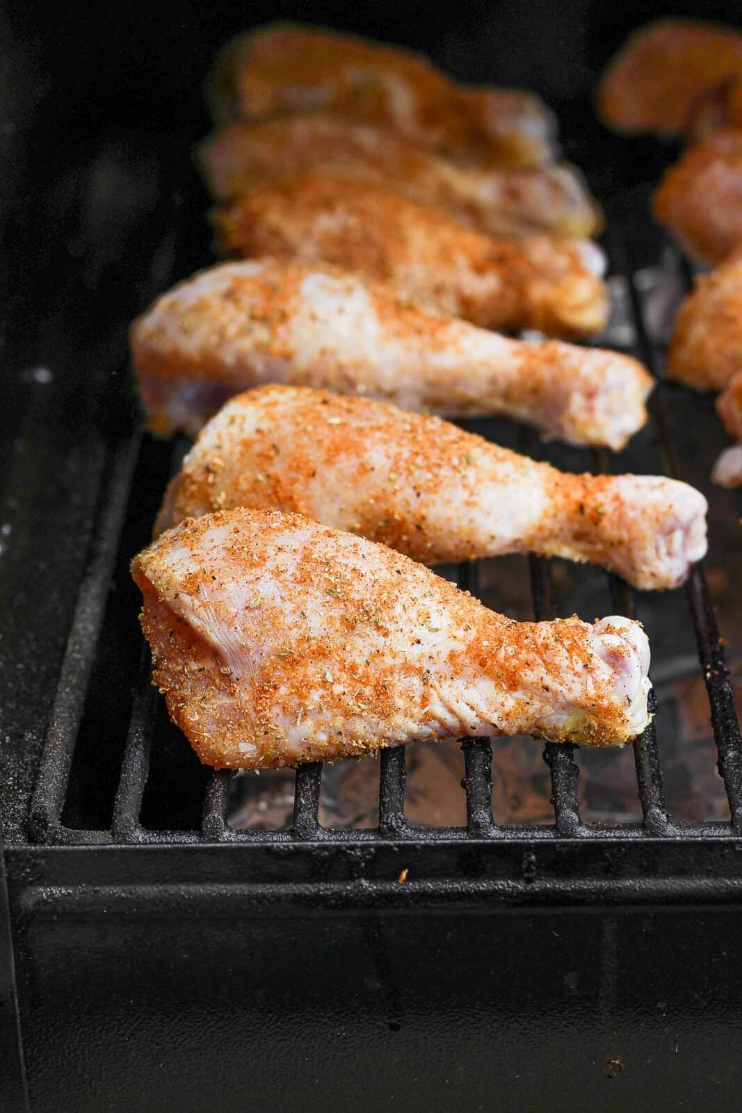 Chicken legs on a smoker.