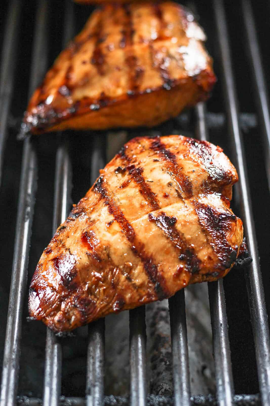 Marinated chicken breasts on the grill.