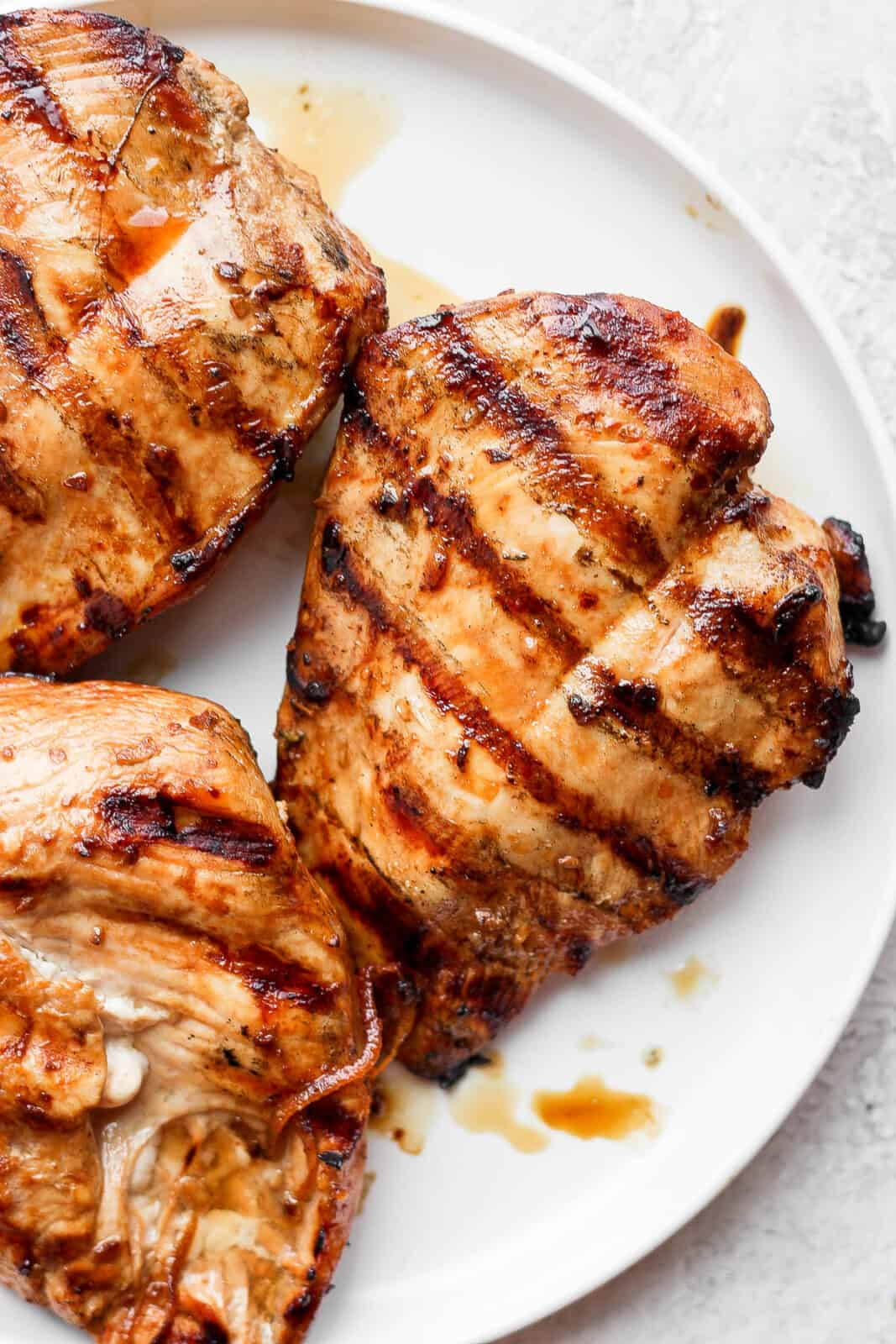 Grilled chicken breasts on a plate.