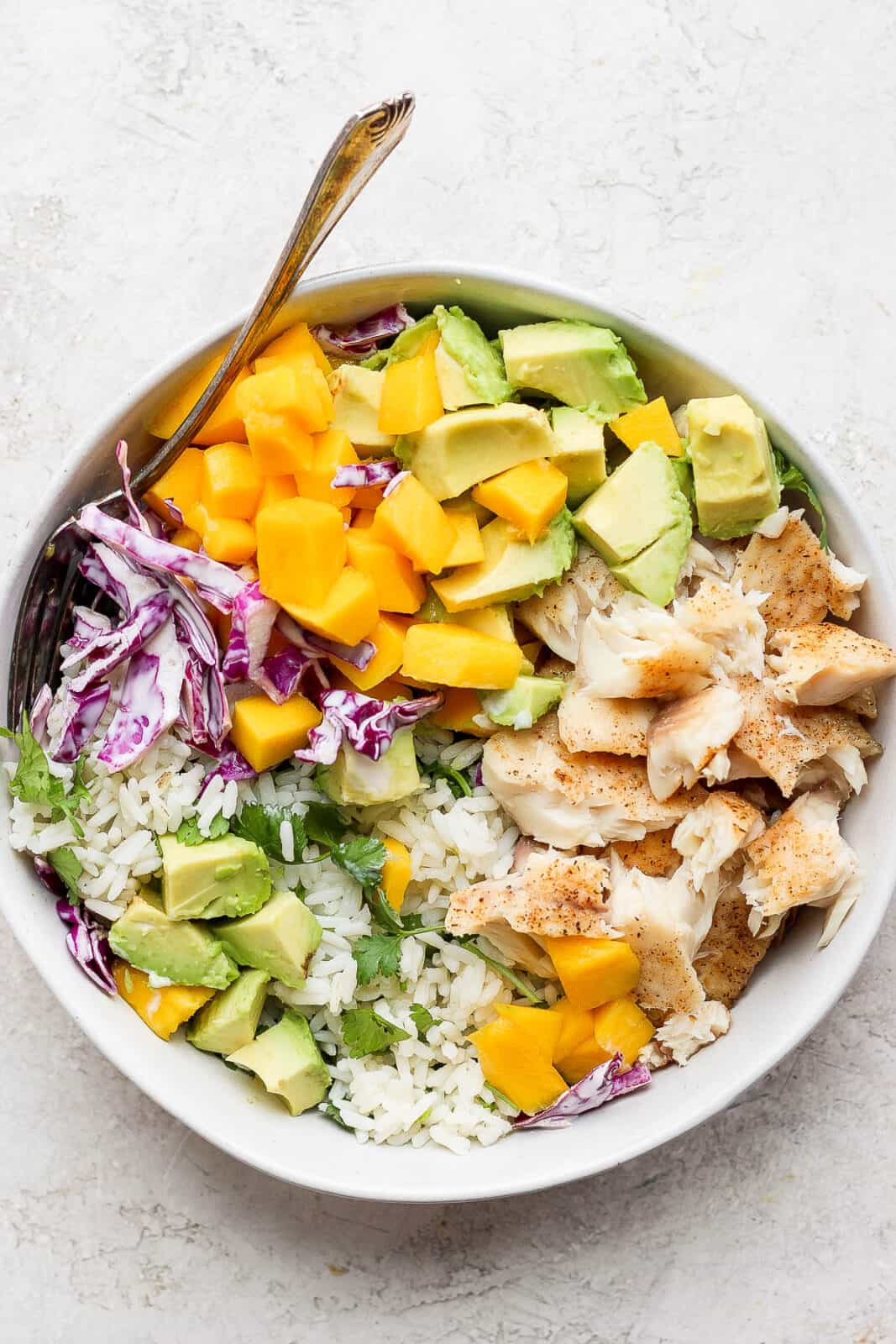 Fish taco bowl with a fork.