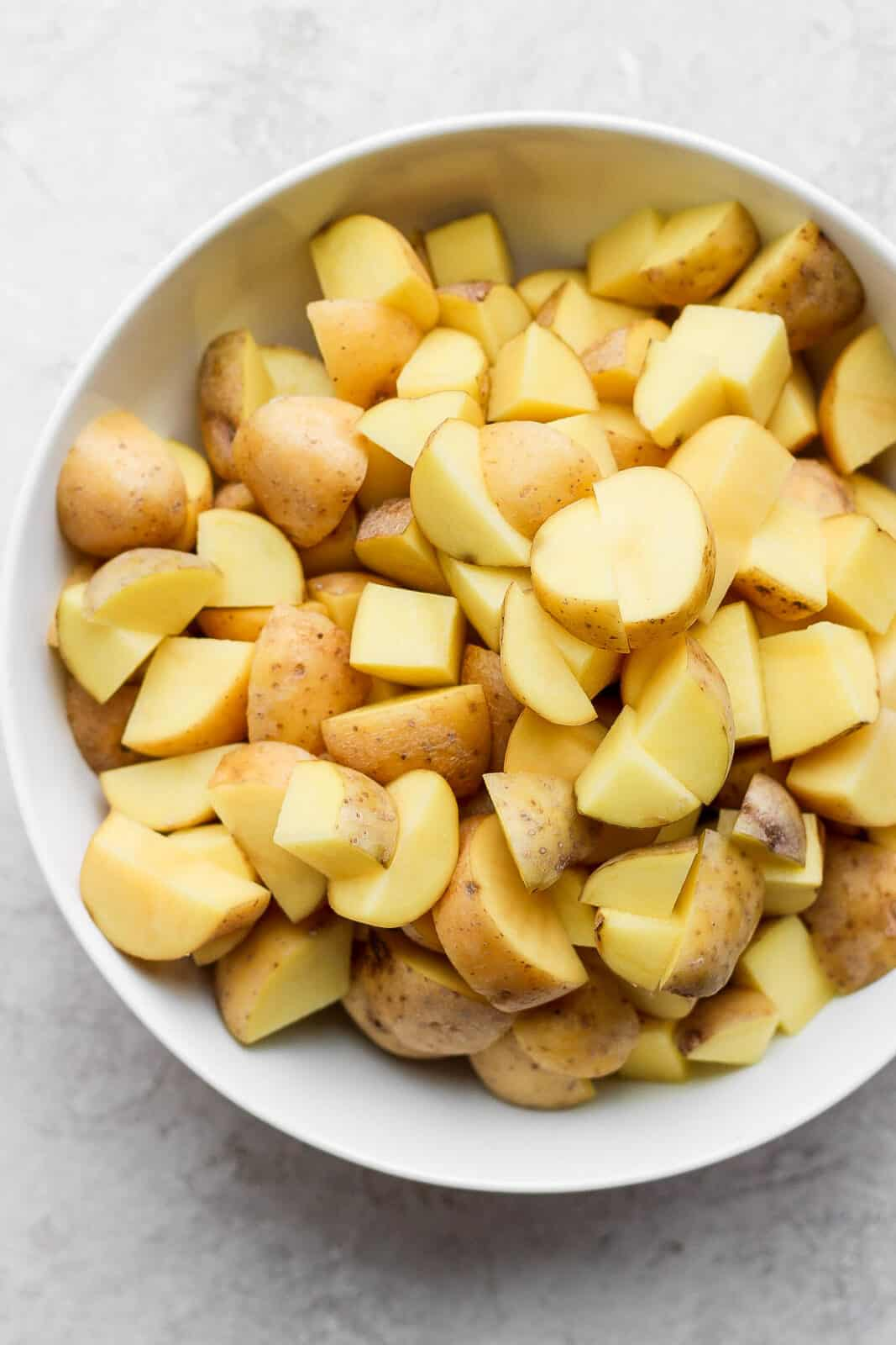 Cut up potatoes in a bowl.