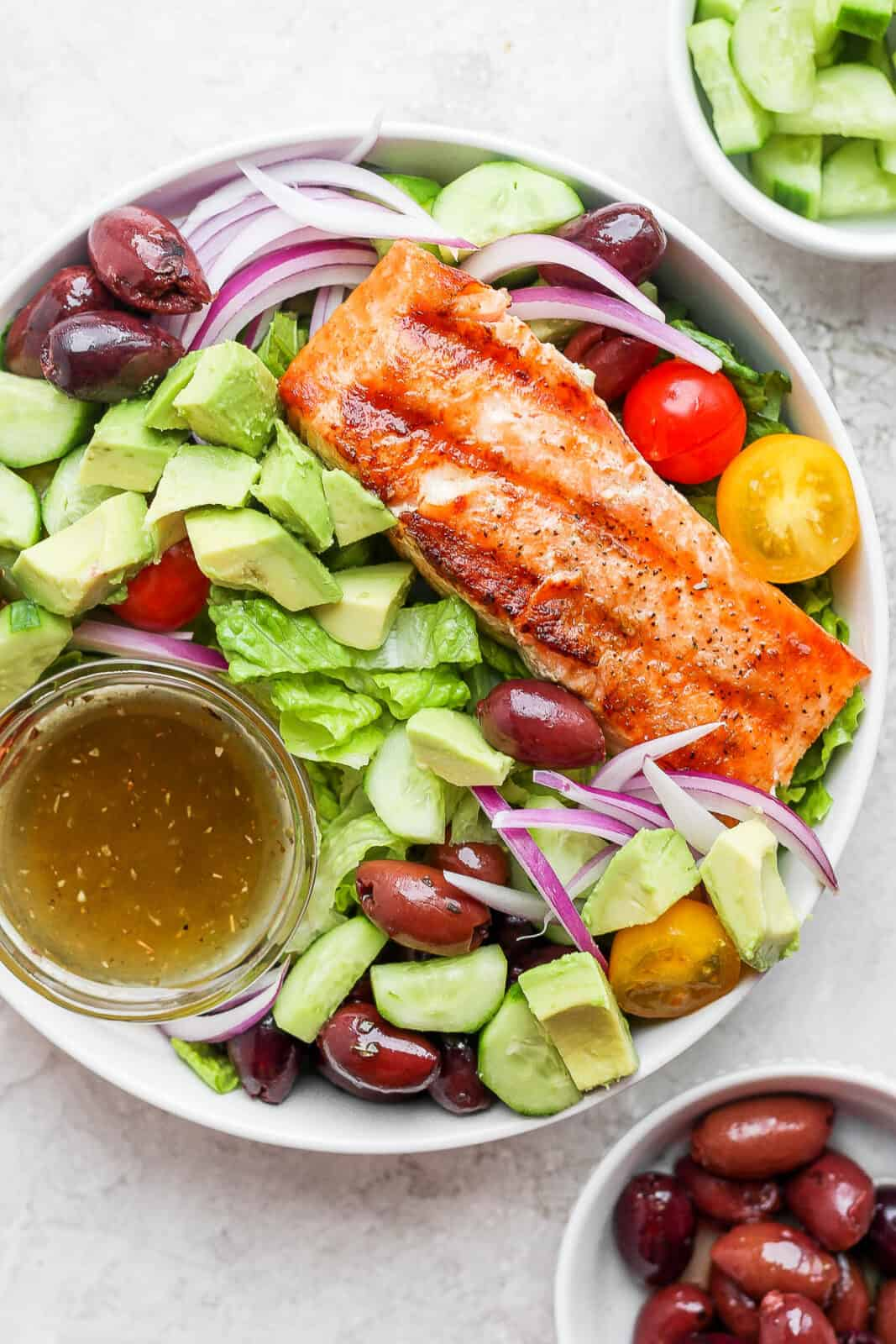 A bowl of grilled salmon salad.