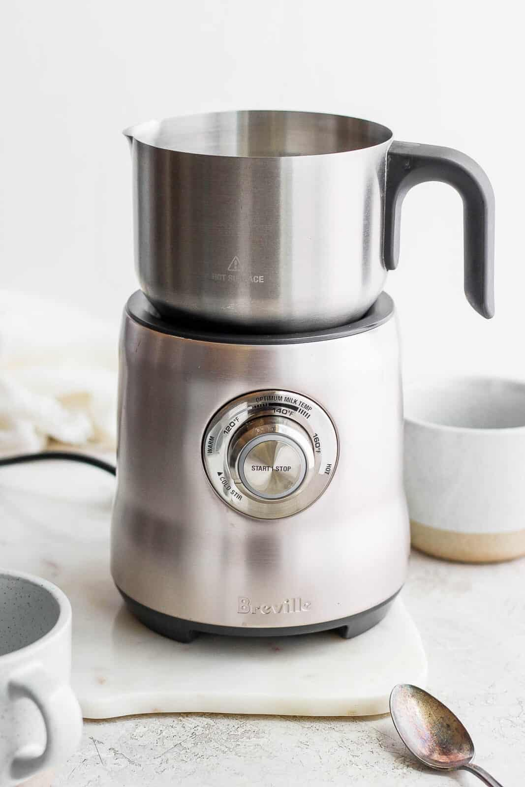 Breville frother and a few cups.