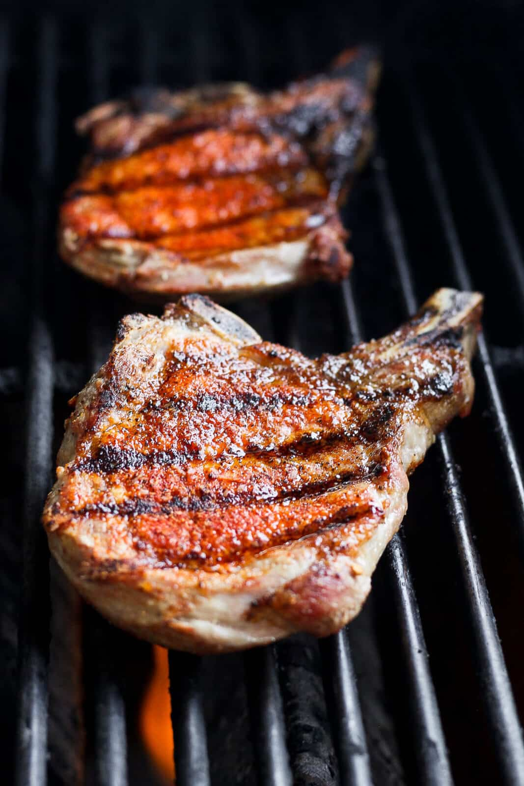Seasoned pork chops on the grill.