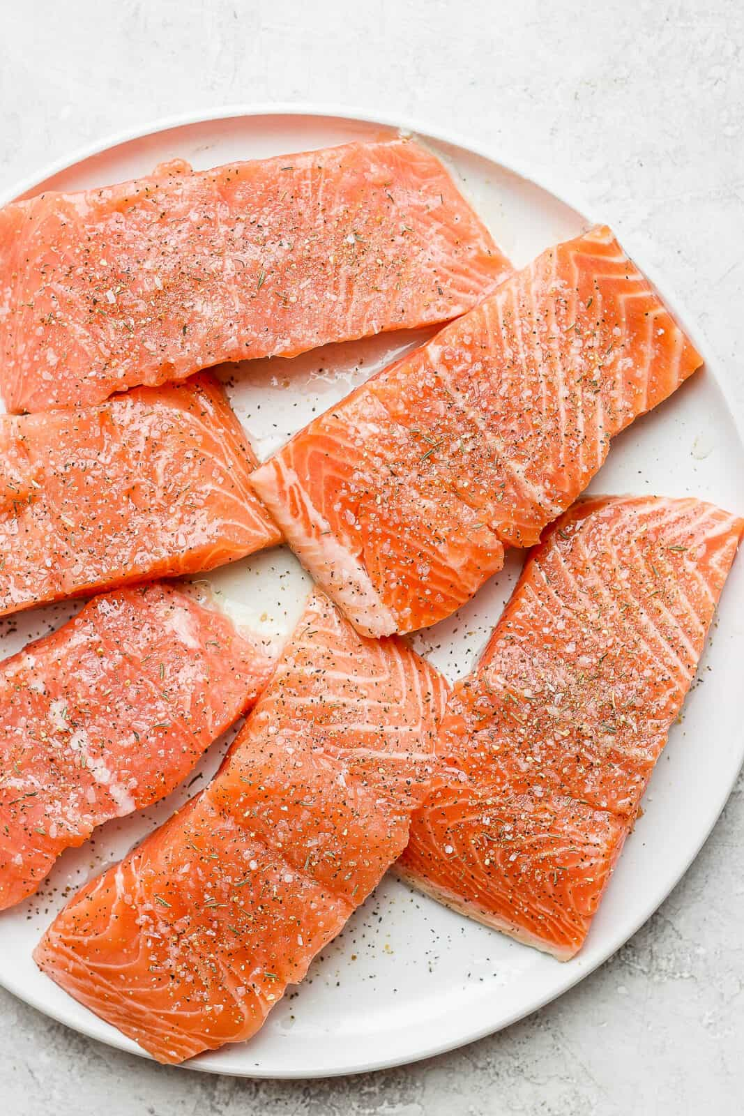 Salmon fillets with salmon seasoning on top.