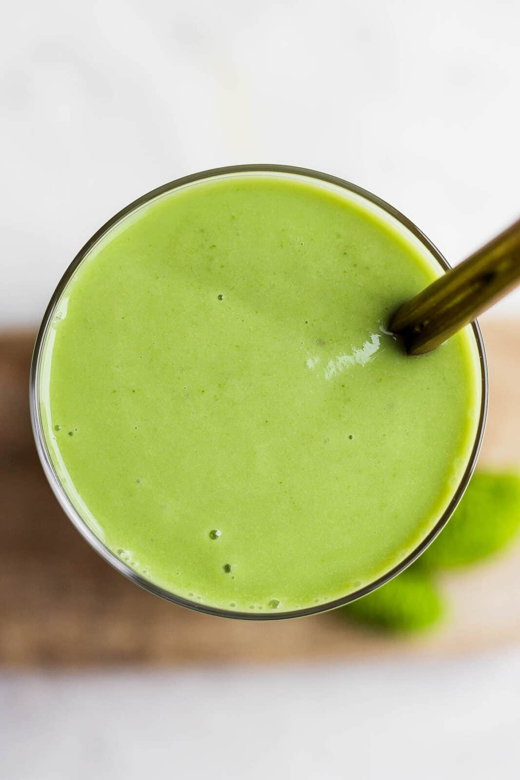 Top view of a green smoothie in a glass.