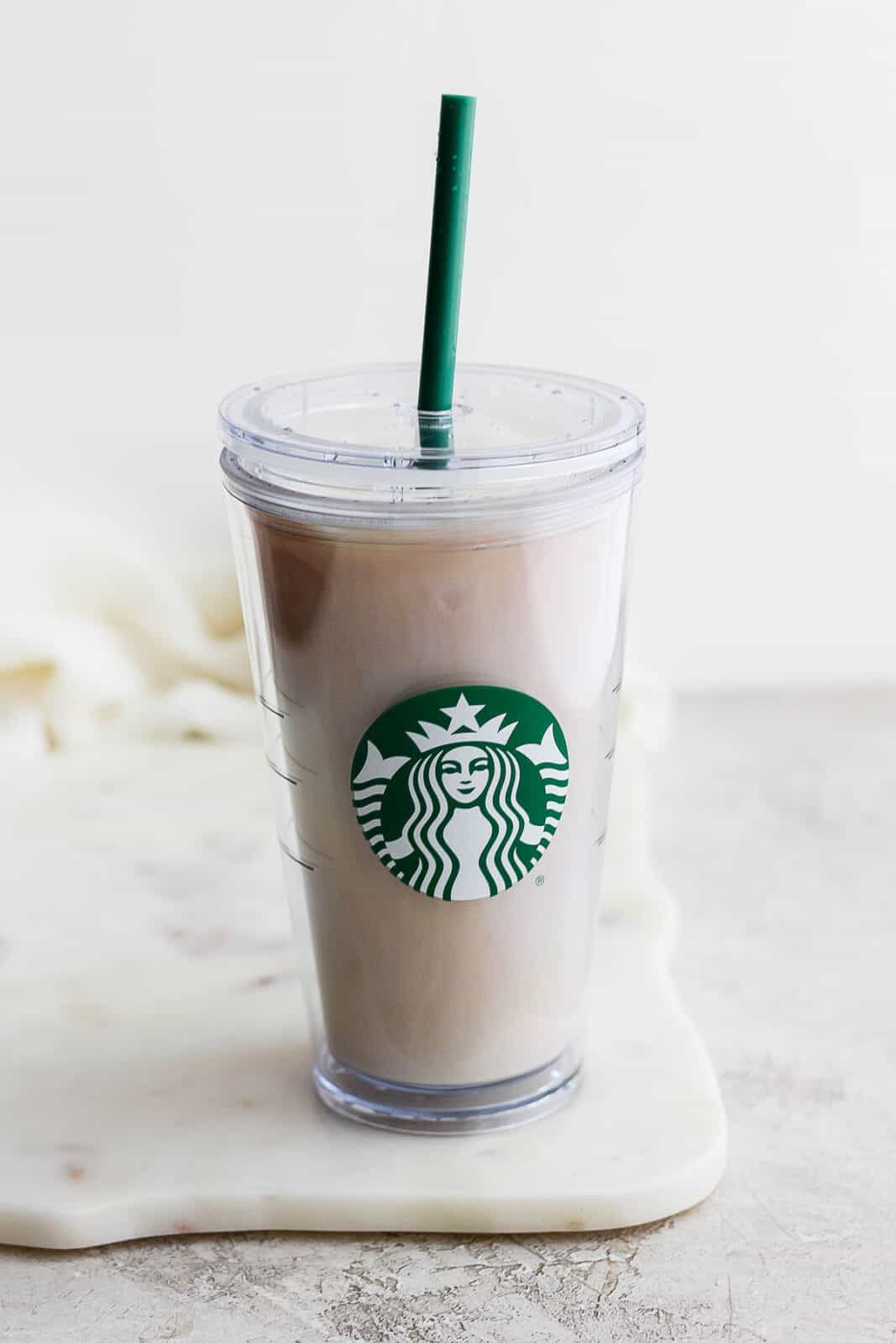 Iced london fog in a starbucks cup.