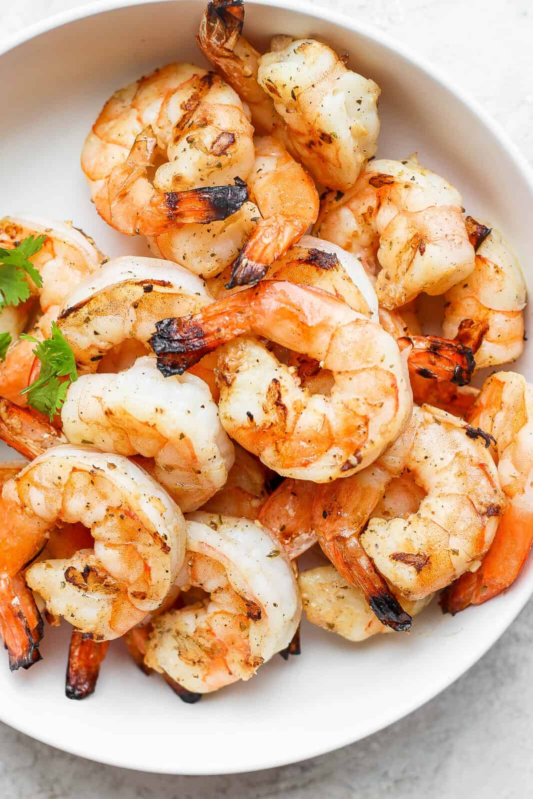 Marinated shrimp that have been grilled in a bowl.