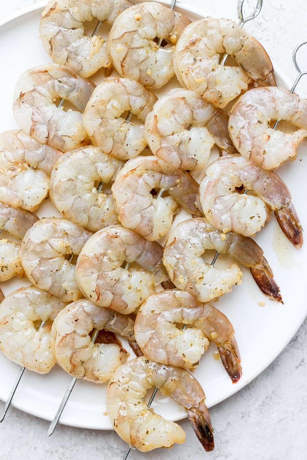 Marinated shrimp on skewers.