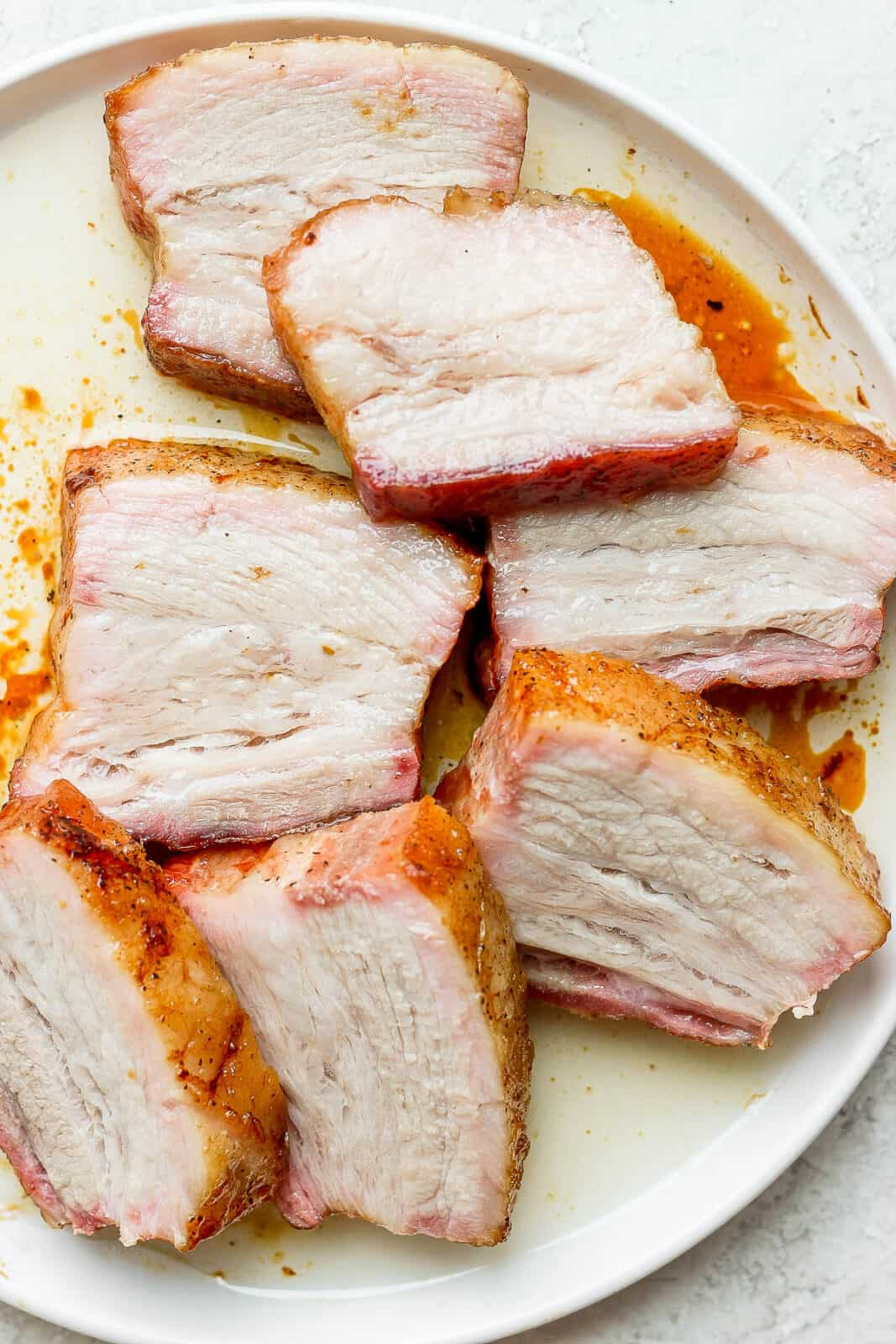 A plate of pork belly slices.
