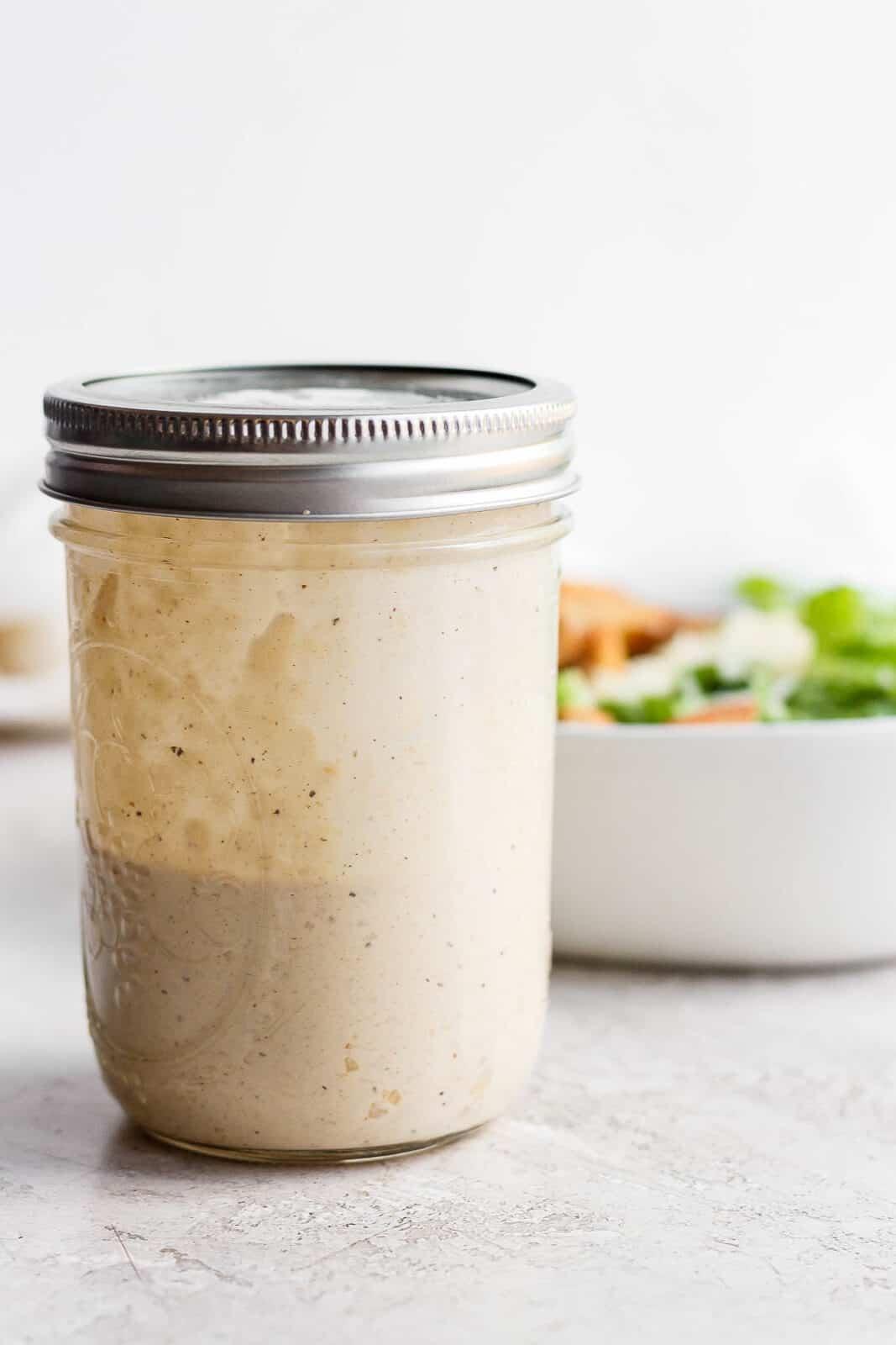 Healthy caesar dressing in a mason jar.