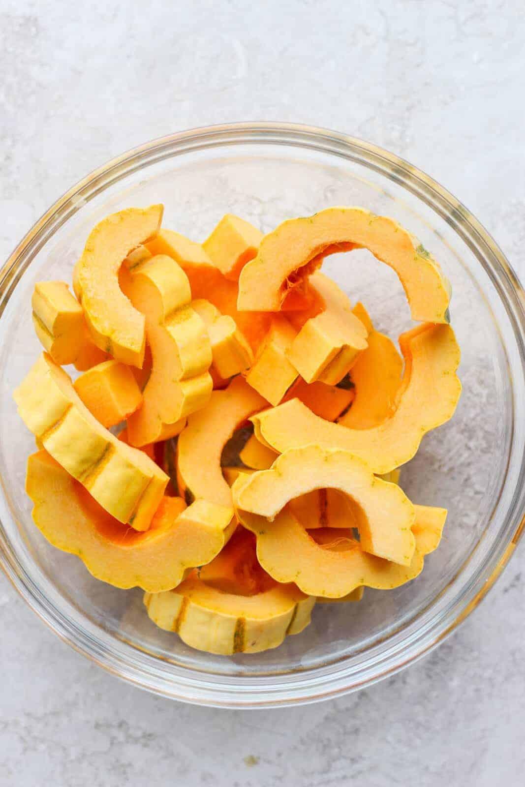 Delicata squash slices in a bowl.