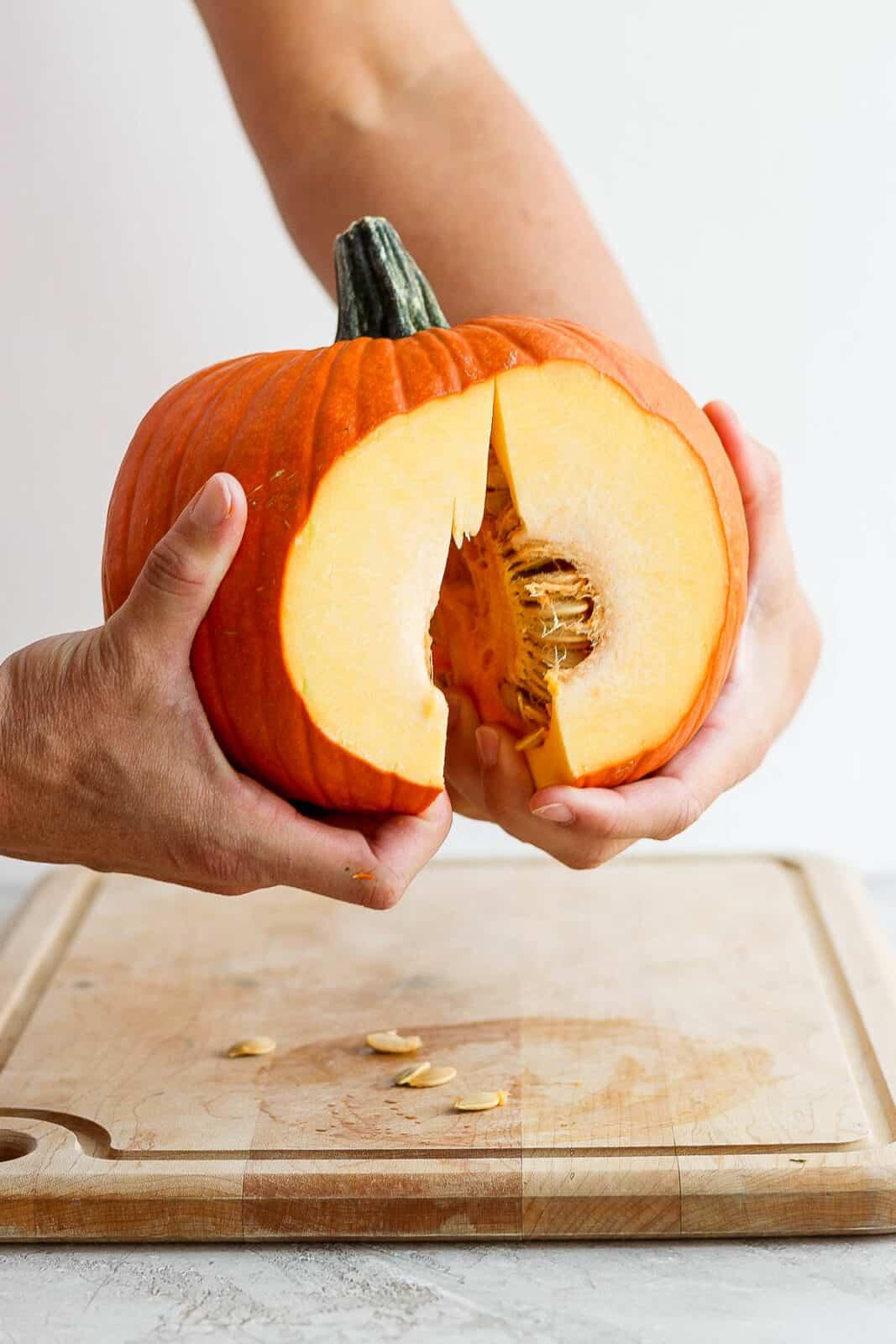 A pumpkin being pulled in half.