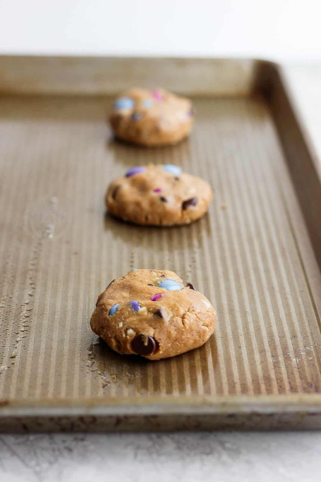 Cookies on a baking sheet before cooking.