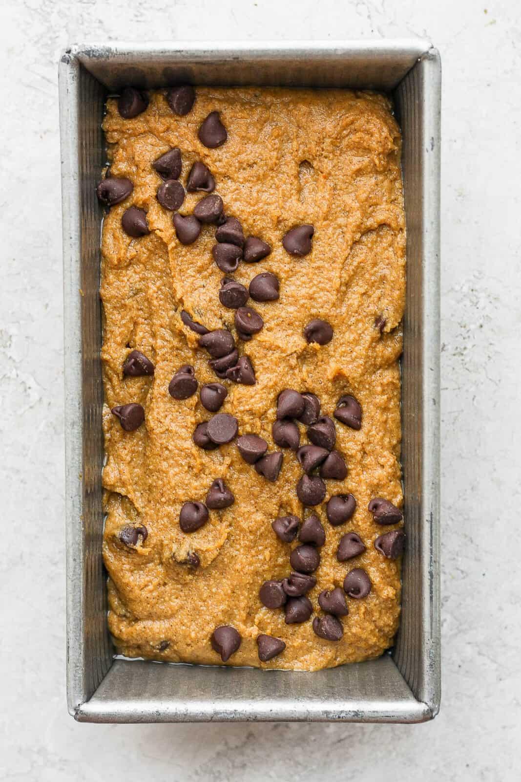 Pumpkin bread batter in a baking pan.