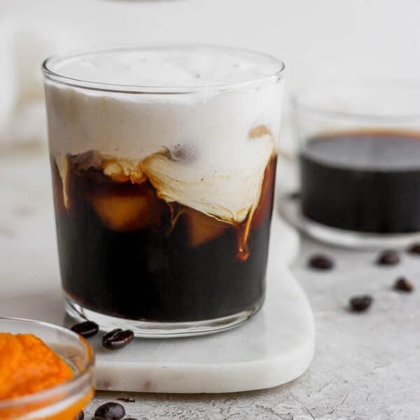 Glass of pumpkin cream cold brew latte.