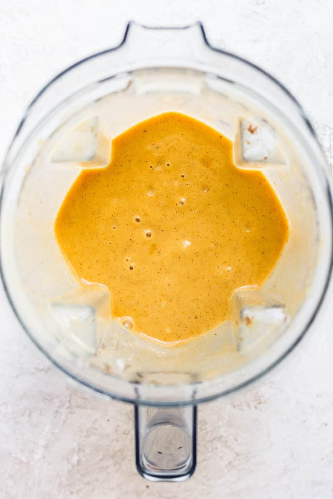 Pumpkin smoothie blended in a blender.
