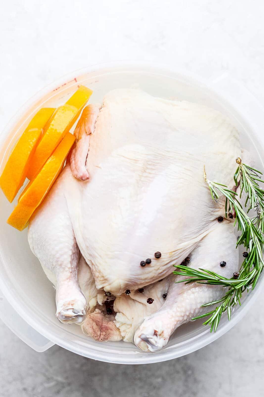 A whole chicken in a smoked chicken brine.
