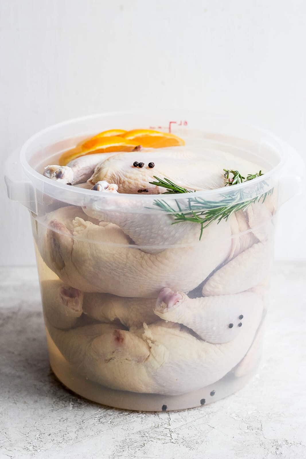 Two whole, raw chickens in a smoked chicken brine.