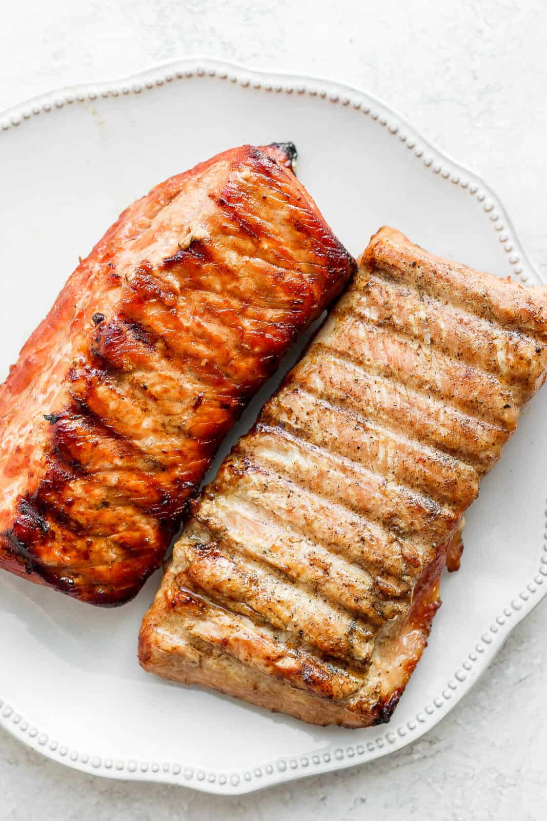 Two smoked pork loins on a plate.